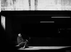 still waiting - waiting - waiting (René Mollet) Tags: walking man blackandwhite bw monchrom monochromphotographie monochrom street streetphotography shadow silhouette garage cigarette renémollet streetart streetphotographiebw basel