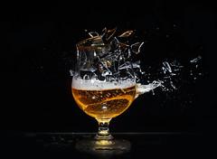 Such a shame! (Wim van Bezouw) Tags: sony ilce7m2 pluto beer splash highspeed plutotrigger blackbackground airgun airpistol glass shatter bullet