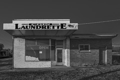 Bunyip VIC (phunnyfotos) Tags: phunnyfotos australia victoria vic gippsland westgippsland bunyip shop laundrette closed vacant lateafternoonlight nikon d750 nikond750 mono bw monotone countrytown coinlaundrette laundry brick awning verandah veranda shopfront lettering text writing typography