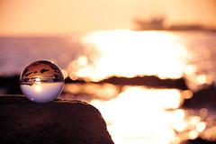 Crystal ball and landscape #1 (daniel0027) Tags: sunlight sunrise earlymorning jeongdongjin seascape crystalball sailingboat bokeh rocks