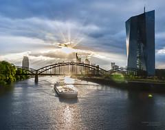 Peeping sun (Itsnotme!) Tags: ecb europeancentralbank skyline sunset main river bridge osthafen frankfurt deutschherrnbrücke west sky evening sun light ray
