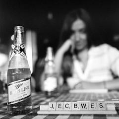 Livin' the High Life (Aaron Bieleck) Tags: hasselblad500cm 120film analog 6x6 square film filmisnotdead hasselblad mediumformat wlvf kodaktmax400 pushed pushedtwostops millerhighlife bokeh beer filmgrain skylinetavern oregon portland pdx sarah scrabble bw blackandwhite grain 10mmextensiontube