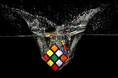 Rubik's Splash (Wim van Bezouw) Tags: rubik cube splash pluto strobist plutotrigger blackbackground highspeed object rubikscube water fishtank