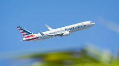 American and Foliage (Ben_Senior) Tags: simpsonbay sintmaarten saintmartin sxm tncm princessjulianaairport fly aircraft aviation flight flying airplane plane airliner airline sky blue clear foliage tree palm palmtree caribbean green yellow orange bensenior focus outoffocus dof depthoffield aperture airport takeoff climb climbout runway dutchwestindies dutchcaribbean nikond7100 nikon d7100 n391aa aa aal americanairlines american boeing 767 763 767300 767300er b767 b763 b767300 b767300er
