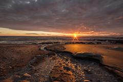 Day's end (zebedee1971) Tags: beach coast river stream water sea waves salt rocky rocks sand surf sun sunset light bright clouds heavy dusk waihi hawera newzealand coastal holiday tasman landscape seascape