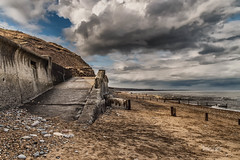 Seaham Prom (robinta) Tags: seaham beach coast sand groyne sea water ocean seascape prom slipway architecture sky clouds moody dramatic robintaylorphotography pentax ks1 sigma18200mmhsmc cliffs rock stones pebbles
