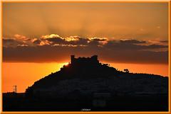 The sun plays  hide and  seek  behind the  castle (ferlancor) Tags: sunset ocasos castillo
