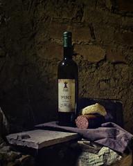 Wine and Bread (NИ) Tags: wine bread salami brickwall attic dust naturallight hedonism