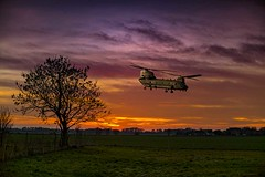 Low flying (bainebiker) Tags: chinookhelicopter lowflyinghelicopter sunset sky clouds tree farmland ultrafastlens canonef50mmf10lusm langtoft lincolnshire uk aircraft