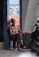 Relaxing (Roving I) Tags: grannies greyhair elderly relaxation resting footpaths street danang vertical vietnam lifestyle