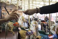 Passing a ring (quinn.anya) Tags: ring hand passing carousel horses
