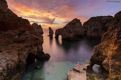 Ponta Da Piedade. (dasanes77) Tags: canoneos6d canonef1635mmf4lisusm tripod landscape seascape cloudscape waterscape sky heaven clouds sea shoreline rocks dawn sunrise colors orange blue reflections shadows portugal algarve lagos pontadapiedade longexposure