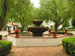 Fountain on a cloudy day (trochford) Tags: california flowers trees cloud brick fountain tile sandiego cloudy terracotta adobe shrub