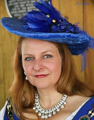 Redhead in Blue (wyojones) Tags: county woman color cute beautiful beauty hat festival lady hair ginger necklace pretty texas dress ellis blueeyes feathers redhead clothes faire earrings lovely jewels redhair renaissance renfest maiden wench waxahachie elliscounty scarboroughrenaissancefestival wyojones