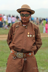 He dresses for the horse race (10b travelling / Carsten ten Brink) Tags: 2012 asia carstentenbrink iptcbasic tradional clothing medals man ulaanbaatar naadam horserace festival national sports mongolia mongolei peopleset 1000plus traditional costume children