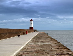 Pier at Berwick-upon-Tweed (Tony Worrall) Tags: county uk light sea england sky lighthouse wet water stone clouds pier town place cloudy walk north visit location historic line coastal walkway northern northeast berwick berwickupontweed ©2014tonyworrall