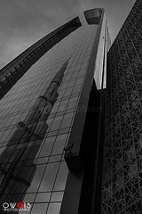 (OwaisPhotography (www.facebook.com/owaisphotos)) Tags: world reflection building architecture canon mirror dubai day image cloudy uae burj dxb tallest emaar buildingexterior manmadeobject 650d builtstructure burjkhalifa owaisphotography gettyimagespakistanq12012 gettyimagesmiddleeast rebelt4i