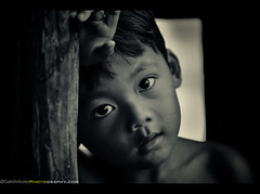 """The countenance is the portrait of the soul, and the eyes mark its intentions."" - Marcus Tullius Cicero, 106 – 43 BC (Sam Antonio Photography) Tags: poverty travel boy portrait people blackandwhite bw playing tree cute male tourism monochrome smile childhood smiling closeup sepia architecture kids work children asian temple happy one eyes ancient asia cambodia southeastasia cambodian khmer child diverse expression buddha traditional innocent poor young culture streetphotography posing diversity angkorwat siem reap tropical ankor southeast siemreap angkor wat visiting ethnic oneperson bwphotography asianboy bayon canon70200f4l destinations candidphotography travelphotography portraitphotography traveldestinations childportrait asianchild canoneos5dmarkii samantoniophotography"