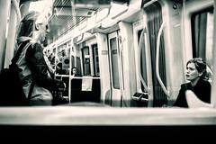 The Serious Talk (Claus Tom) Tags: street blackandwhite bw woman female copenhagen subway denmark women publictransportation metro candid streetphotography transportation cph kbenhavn