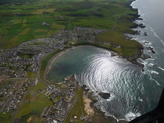 Portballintrae: North Antrim coast (ronmcbride66) Tags: bay waves aerialview erosion golfcourse legacy concentric bushmills groynes scouring caravans coantrim longshoredrift northantrim portballintrae bushfoot waverefraction legacygallery concentricpattern sunrays5
