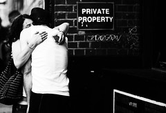 Private Property (Luminor) Tags: uk light england people woman man brick london love contrast blackwhite nikon hug perfect emotion availablelight streetphotography 85mm east lane sin passion embrace tones benedict luminor shotwideopen streetoggs