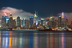 Foggy Night Over NYC [EXPLORE] (Moniza*) Tags: city nyc newyorkcity longexposure cloud mist ny newyork reflection water misty fog skyline night skyscraper river geotagged newjersey rainbow nikon cityscape manhattan foggy illumination newyorker midtown explore nightlight esb hudsonriver empirestatebuilding gothamist bluehour unioncity hoboken weehawken gothamcity thebigapple westnewyork lightstream unionhill d90 onepennplaza explored moniza