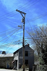 Telegraph Tuesday - Old Columbia Pike, Ellicott City, Maryland (A CASUAL PHOTGRAPHER) Tags: ellicottcity howardcounty maryland telegraphtuesday powerlines utilitypoles tonguerow tongerow oldcolumbiapike stonebuildings historictowns