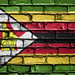 National Flag of Zimbabwe on a Brick Wall