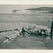 Wrak van een neergehaald Duits vliegtuig ergens aan de Noord-Franse kust, ca. mei-juni 1940   The wreck of a German plane, somewhere on a beach somewhere in Northern France, c. May-June 1940
