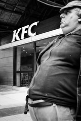 KFC (Alex Cruceru) Tags: 2015 bw belly blackwhite blackandwhite bucharest candid city fujifilm garadenord man mirrorless moments mono monochrome monochromephotography romania silverefex stradal street streetphotography streettogs urban