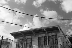 looking up, architectural forms, power lines, hanging beads, clouds, Magazine Street, New Orleans, Louisiana, Nikon D40, Sigma 18-50mm f-2.8, 4.19.17 (steve aimone) Tags: architecture architecturalforms powerlines beads hangingbeads clouds magazinestreet neworleans louisiana nikond40 sigma1850mmexdcmacro blackandwhite monochrome monochromatic cityscape