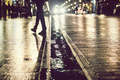 Nightlife .... (eggii) Tags: man night evening street lighting people wet city guy vintage