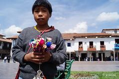 child Vendor Plaza de Armas Cuzco (Josadaik Alcntara Marques) Tags: street boy vacation holiday peru southamerica childhood cuzco photo cusco sony nios kind pe enfant boyhood nio sudamerica bambinos garom dijete puer infano tamaiti discoveringperu passionshots
