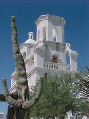 San Xavier Mission with Candelabra Saguaro (Kate McGahan) Tags: sky building church architecture religious tucson mission sanxaviermission candelabracactus whitedoveofthedesert