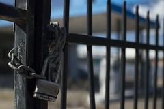 Locked Out (Rikardo daVinci) Tags: 35mm fence buildings nikon lock gates padlock abandonedbuilding narrowdof lockedout