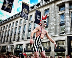 The Gumball 3000 circus comes to Regents street (hethelred) Tags: street leica portrait man london 35mm costume circus voigtlander rally unicycle 12 3000 crowds nokton act gumball regents entertain m9 aspherical