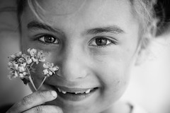 Put some flowers in your guns (Giulio Magnifico) Tags: flower eye girl contrast turkey happy eyes war child little refugees young streetphotography photojournalism streetportrait syria reportage nikond800e nikkormicro105mmafsvrf28