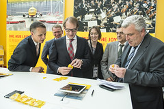 Alexander Dobrindt and Frédéric Cuvillier on the DHL stand