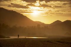 Lovers' Sunset (Greg - AdventuresofaGoodMan.com) Tags: ocean sunset orange lake mountains reflection beach colombia amor playa columbia lovers tayrona caribbeancoast tyrona arrecifes tayronanationalpark parquenacionaltayrona greggoodman