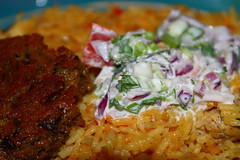 Traditional pilau rice served with shami kebabs and raita (WorldClick) Tags: red food chicken home canon tomato eos photo spring yummy flickr colours photographer with rice indian traditional cucumber spice salt dal powder east made cocktail photograph delight served pakistani onion spicy chilli turmeric cumin eastern kebab tarka haldi flavour raita pilau cusine kebabs jeera shami riata phototgraphy dhaniya cuminpowder 1100d zeera canoneos1100d chapti spicykebabsservedwithtarkadal cocktailrice riataandhomemadechapti traditionalpilauriceservedwithshamikebabsandraita worldclick