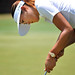 American golfer Michelle Wie stands over a putt at Pinehurst No. 2.