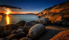marrepanna (olisko) Tags: blue sunset red sky sun water clouds rocks long exposure