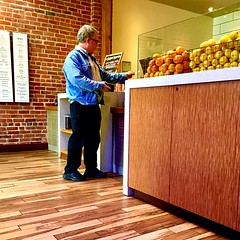 Lemons for Lunch • 2016 (xBReXx) Tags: warmcolors real life people streetphotography lunch customer walls brick wood lemon brown yellow