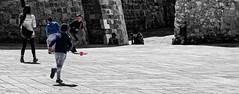 Play time (mazzottaalessandra) Tags: bambini children childhood gioco palla ball calcio football otranto strada piazza place centro storico old monocromo colorazione selettiva colori colors colore movimento move correre run canon contrast ombre shadow shadows light saturday morning innocenza innocence italy sea seaside mare street urban life