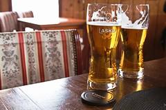 Cheers/Živeli! (salaminijo) Tags: beer pivo table beverage food indoor glass bokeh lightanddark light canon bier olut piwo cerveja labiere fresh coldbeer laško
