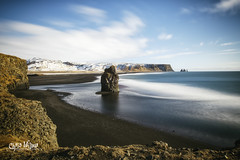 The Black Sand of Kirkjufjara Beach (wilbias) Tags: sky water beach blue north coast ocean rock sand black shore long exposure atlantic south iceland kirkjufjara