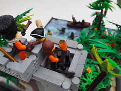 The Fall of the Mardierian Fort on Isla de la Many Names (Robert4168/Garmadon) Tags: lego eslandola mardier isla de la many names victoria palm vegetation cliffs rock twotoned explosion fort mini water boat soldiers war sand path grey green black jungle foliage