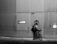 Dismount (Jonathan Vowles) Tags: bike bycycle lines london wall sign cyclist