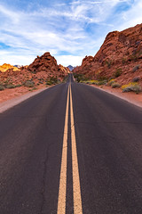 Through The Valley of Fire I (Dino Sokocevic) Tags: desert nevada tokina nikon ultrawide road adventure travel driving symmetry leadinglines roadtrip sunset blue sky clouds