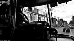 Trams and Traffic. (Neil. Moralee) Tags: neilmoralee traffic tram street streetcar transport ttc pcc toronto canada driver stuck inside candid neil moralee panasonic lumix lx7 black white bw bandw blackandwhite contrast mono monochrome frustration work working anotherdayatwork